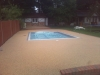 Bonded aggregate paving around pool