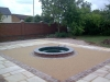Bonded aggregate paving around a fountain
