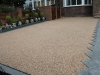 Bonded aggregate paving and stone pathway