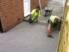 Laying bonded aggregate paving